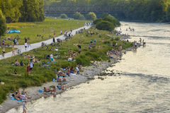 People on Isar river, Munich, Germany Stock Photo
