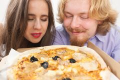 Couple eating pizza, having fun together royalty free stock photo