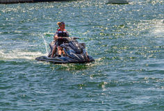 People on a jetski Stock Image