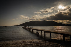 People on jetty at Santa Giulia beach in Corsica Stock Images