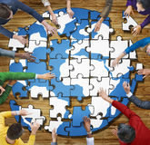 People with Jigsaw Puzzle Forming Globe Photo and Illustration Royalty Free Stock Photo