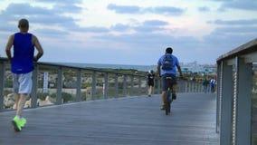 People jog in Tel-Aviv near the coastline stock video footage