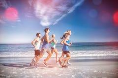 People jogging on beach Stock Photos