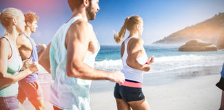 People jogging on beach Royalty Free Stock Photos