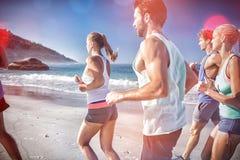 People jogging on beach Stock Image