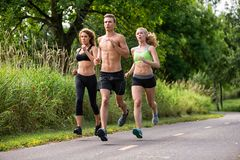 People Jogging Stock Photography