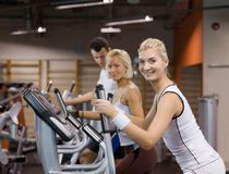 People jogging in a gym. Group of people jogging in a gym royalty free stock photo