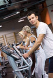 People jogging in a gym Royalty Free Stock Photos