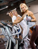 People jogging in a gym. Group of people jogging in a gym stock image