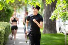 People jogging in the park Stock Photo
