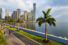 People jogging in a sidewalk near the Panama City Finantial District, in Panama Royalty Free Stock Images