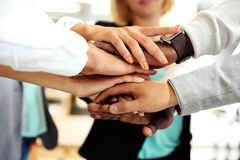 People joining hands stock images