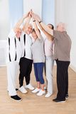 People joining hands together at gym Royalty Free Stock Image