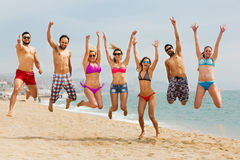 People jumping at beach Stock Photography