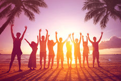 People jumping at beach. Silhouette of friends during sunset time Royalty Free Stock Photography
