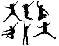 People jumping in black Stock Photography