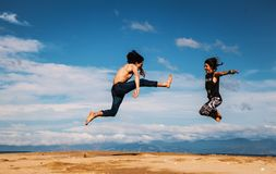 People jumping in countryside Royalty Free Stock Images