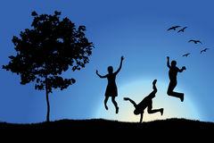 People jumping and dancing on hill near tree Stock Photography
