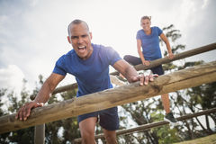 People jumping over the hurdles during obstacle course Royalty Free Stock Image
