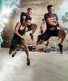 People jumping and practicing cardio fitness exercise Royalty Free Stock Images
