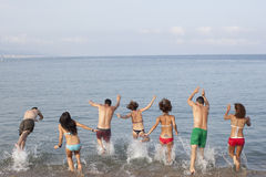 People jumping into the sea Royalty Free Stock Image