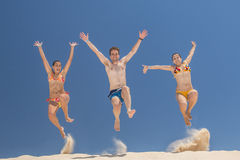 People jumping in summer Stock Images