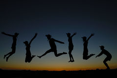 People jumping at sunrise Stock Photography