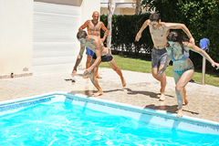 People jumping to swimming pool Stock Images