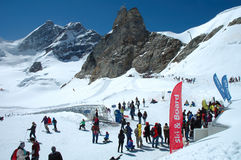 People on Jungfaujoch pass in Switzerland. Stock Images