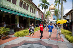 People in the Kampong Glam, Singapore. SINGAPORE - CIRCA FEBRUARY, 2015: Tourists in the Arab quarter (Kampong Glam). The Arab Quarter is the oldest historic Stock Photo