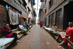 People from Katmandu suburbs living in poverty. KATHMANDU - OCT 10: People of Kathmandu suburbs trying to survive in the daily life. They live in narrow streets Stock Images