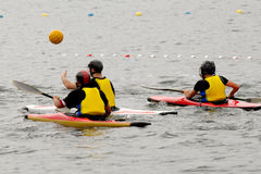 People in kayak playing polo Royalty Free Stock Images