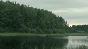 People on a kayak sail along. The skerries of the Ladoga lake stock video