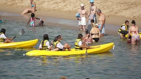 People kayaking at the beach stock footage