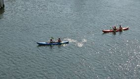 People kayaking on Motlawa river in Gdansk, active life and sport, hobby. Stock footage stock footage
