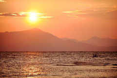 People kayaking on the Shkodra Lake at sunset Royalty Free Stock Photo