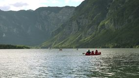 People kayaking on Slovenian lake Bohinj stock video