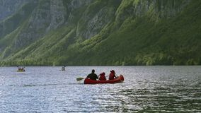 People kayaking on Slovenian lake Bohinj stock video footage