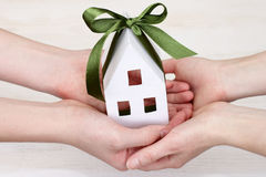 People keep the image of the house in hands Stock Images