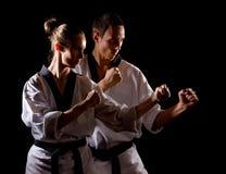 People in kimono make martial arts exercise stock photo