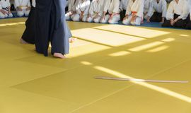 People in kimono on martial arts weapon training seminar. People in kimono on martial arts weapon master class stock photography