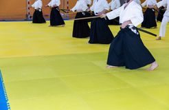 People in kimono on martial arts weapon training seminar. People in kimono practice Iaido on martial arts weapon training seminar stock photo
