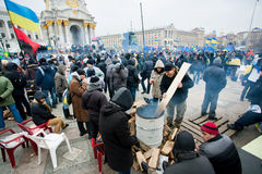 People kindle fire on the cold occupying Maidan square during two weeks anti-government protest Stock Photos
