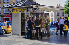 People at a kiosk newsagent in Madrid. A view of people looking at a news agent kiosk in the centre of Madrid royalty free stock photography