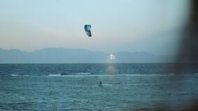 People Kite surfing in beautiful clear water in Dahab Egypt point of view from window. Exploring the blue sea with
