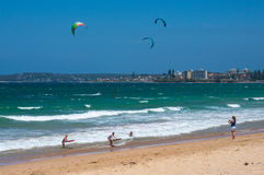 People kite surfing and bodyboadring on Cronulla beach Royalty Free Stock Image