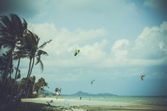 People kite surfing near the beach in retro style Royalty Free Stock Image