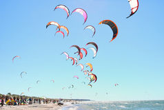 People kiteboarding. Kiteboarding competition, many kites in the sky Royalty Free Stock Photos
