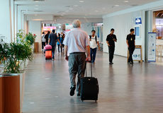 People at KLIA airport, Malaysia. People walking at the Departure Hall at KLIA airport in Malaysia. KLIA is the largest and busiest airport in Malaysia. KLIA Stock Images