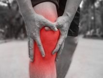 People with knee pain and feeling bad hand on he knee, healthy concept.  royalty free stock photo